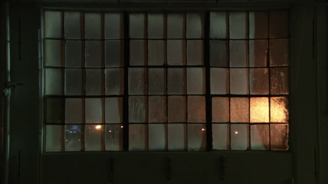 WIDE ANGLE OF WAREHOUSE WINDOW. INDUSTRIAL BUILDING.