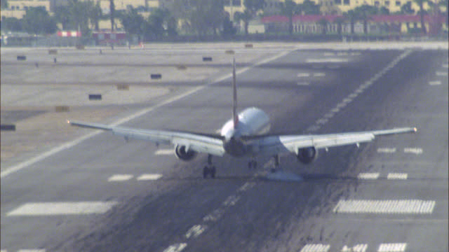 up angle of commercial airplane or jet landing on airport runway. series. - anno 1994 video stock e b–roll