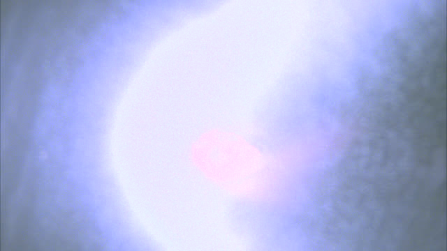 wide angle of fireball or comet streaking down left in outer space past stars, glowing white leaving trails. special effect. outerspace. - special effect stock videos & royalty-free footage
