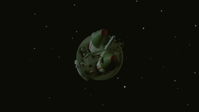 wide angle of satellite or missile launcher in space. two missiles rockets. black and starry bg. drifting and spinning. special effect model - special effect stock videos & royalty-free footage