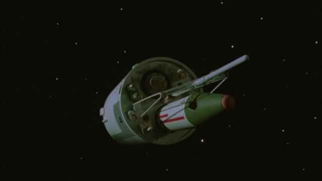 wide angle of satellite or missile launcher in space. missiles or rockets. black and starry bg. drifting and spinning. special effect model - special effect stock videos & royalty-free footage