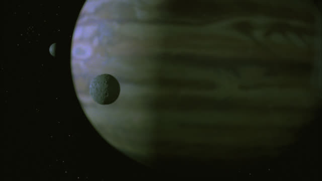 wide angle of space with large planet with two moons or satellites. black and starry bg. special effect model. - special effect stock videos & royalty-free footage