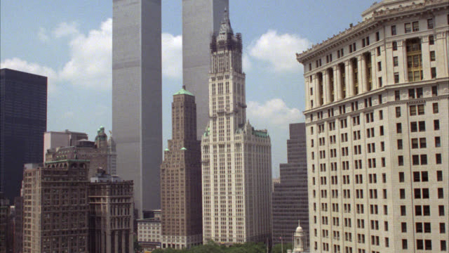 wide angle of skyscraper, high rise office buildings in new york city. woolworth building and transportation building in lower manhattan. world trade center, twin towers in bg.  cities. matching clip 0555-901. - woolworth building stock videos & royalty-free footage
