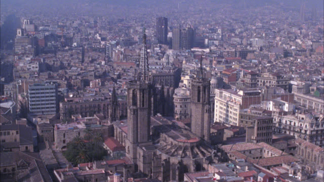 aerial over barcelona. buildings, cityscapes. pass cathedral of barcelona, also known as the cathedral of santa eulalia with spire or tower. cities. gothic cathedrals. - spire stock videos & royalty-free footage