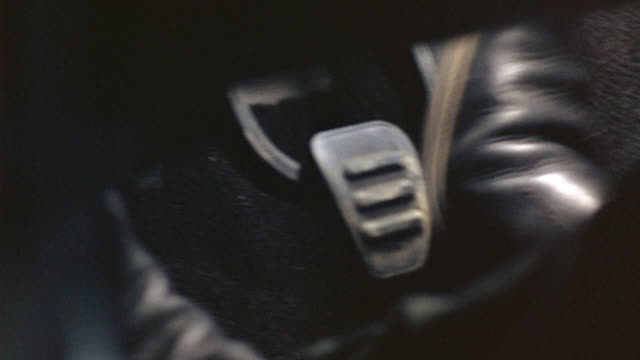close angle of a man's feet hitting the gas and shifting gears with the car pedals while driving a car. - pedal stock videos & royalty-free footage
