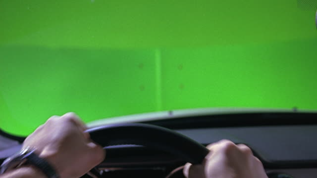 hand held drivers pov shot of a man's hands on the steering wheel of a car or sedan.  his hands tightly move back and forth as if he's driving fast.  special effect green screen. - special effect stock videos & royalty-free footage