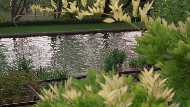 wide angle of moat in front yard garden or mansion. - moat stock videos and b-roll footage