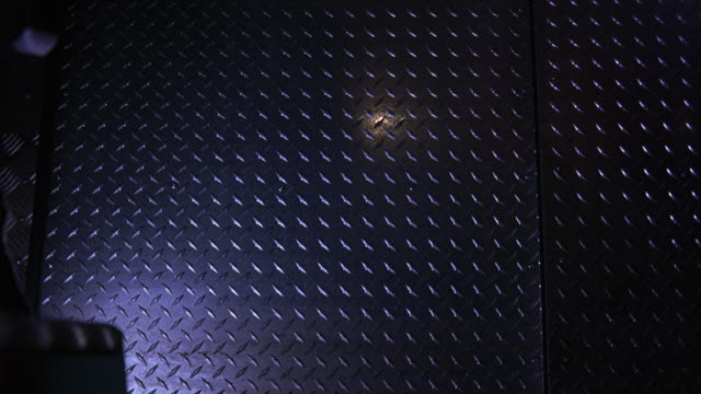 medium angle interior of mercedes-benz vario armored car, truck, or van. metal, possibly aluminum, siding. could be military personnel vehicle. - armored truck stock videos and b-roll footage