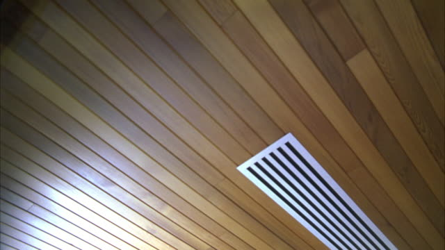 up angle of wood ceiling. air ducts. could be loft or warehouse. pan down to library stacks, books, and desks. could be academy or university building - air duct stock videos & royalty-free footage