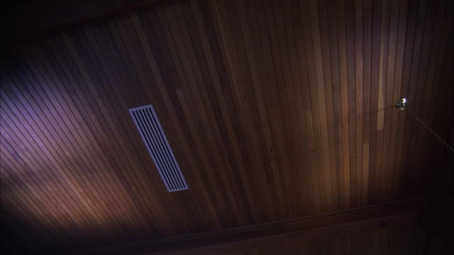 up angle of wood ceiling. air ducts. could be loft or warehouse. - loft stock-videos und b-roll-filmmaterial