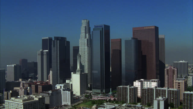 AERIAL VIEW OF LOS ANGELES SKYLINE AND SURROUNDING BUSINESS OR FINANCIAL DISTRICT. VARIOUS HIGH RISE, OFFICE BUILDINGS, AND MULTI-STORY BUILDINGS. US BANK TOWER.