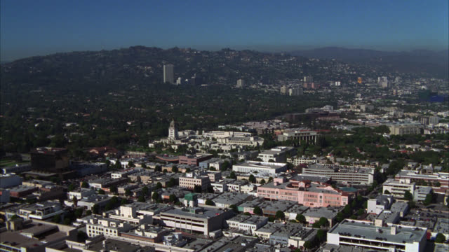 aerial of mormon temple on santa monica blvd or church of latter day saints. palm trees at entrance of building. various office buildings, high rise building, and apartment buildings. light traffic on surrounding streets. - santa monica blvd stock videos & royalty-free footage