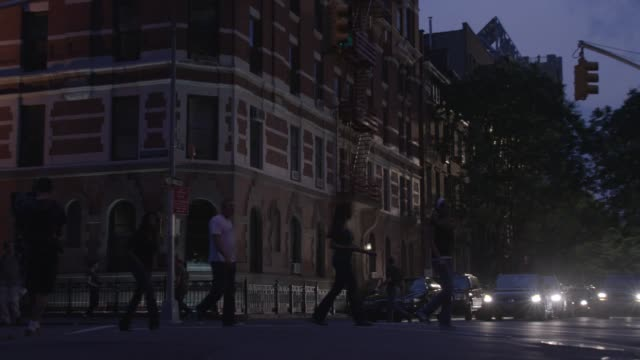 """ZOOM IN ON MULTI-STORY, MIDDLE TO UPPER CLASS, BRICK APARTMENT BUILDING IN GREENWICH VILLAGE. MANHATTAN, AT 4TH AND MACDOUGAL. PEOPLE WALKING, PEDESTRIANS IN CITY STREET CORNER. CARS AND TAXIS.<P><A HREF=""""HTTPS://WWW.SONYPICTURESSTOCKFOOTAGE.COM/FOOTAGE?K"""