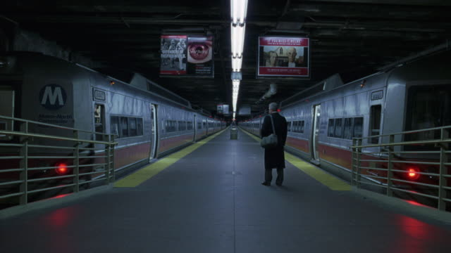 "wide angle of empty underground subway station platform. two subway trains are stopped with doors open. see man in suit standing on platform and run into subway car on left and doors close. could be commuter. see sign on train says ""m"" and ""metro north"". - vehicle door stock videos & royalty-free footage"