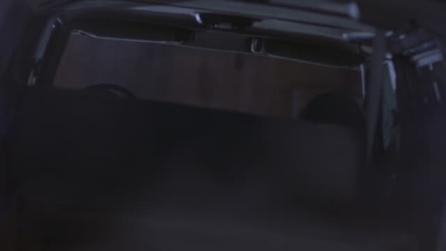 medium angle of back seat of hummer h1 car. see smoke in front of car. backseats. dutch angle. - hummer stock videos and b-roll footage