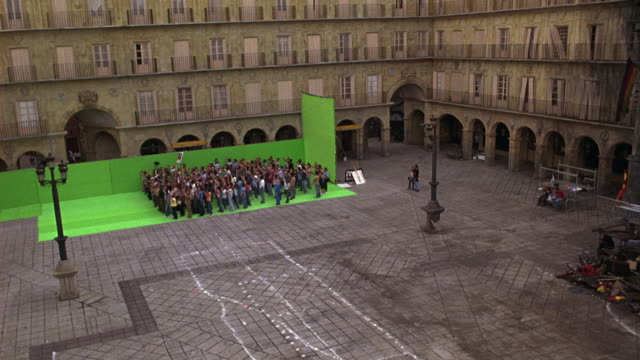 wide angle of crowd of people cheering in plaza courtyard against green screen. plaza mayor, europe. could be for protest or rally. - courtyard stock videos and b-roll footage