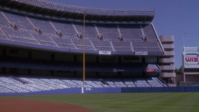 wide angle of empty bleacher seats and baseball field at yankee stadium in the bronx new york. - baseball diamond stock videos and b-roll footage