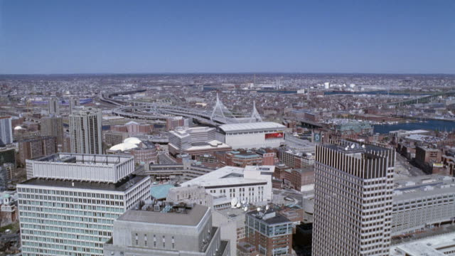 wide angle of downtown boston, skyscrapers and high rise office buildings, multi-story apartment buildings. freeway, expressway or highway. leonard p. zakim bunker hill memorial bridge. charles river. horizon in background. cities. new england. - boston stock videos and b-roll footage