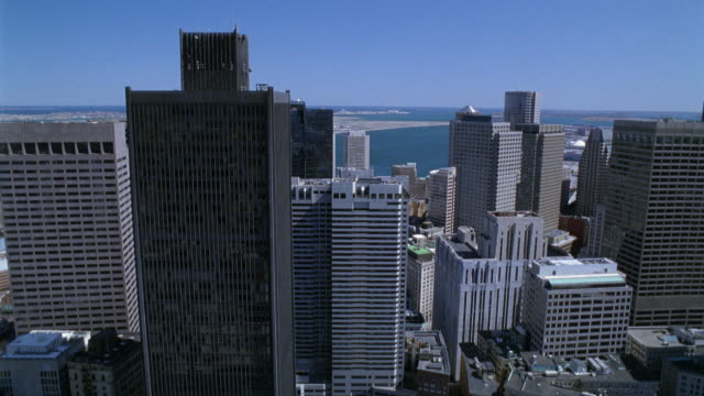 wide angle of downtown. skyscrapers and high rise office buildings including one boston place. city skylines. horizon over the atlantic ocean in background. new england. - boston stock videos and b-roll footage
