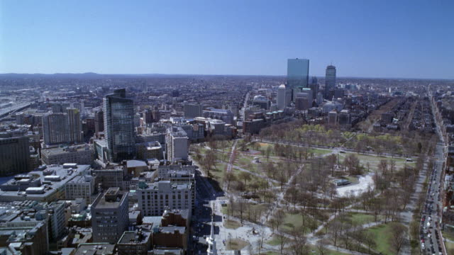 wide angle of downtown boston. skyscrapers, high rise office or apartment buildings. boston common park. cars on city streets. horizon in background. - boston stock videos and b-roll footage