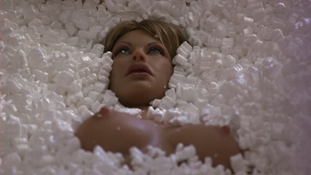 close angle of mannequin or life-size doll of naked woman. packed in crate in styrofoam peanuts. - 1994 stock videos and b-roll footage