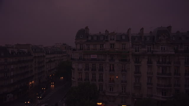 wide angle of paris apartment buildings or hotels. car traffic on boulevards or city streets. 19th century architecture dormer windows. upper class. - dormer stock videos and b-roll footage