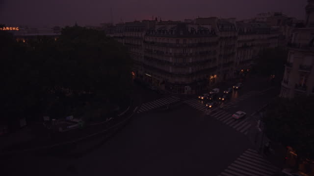 high angle down of urban skyline obscured by trees. 19th century architecture.  dormer windows. see le bon marche sign and eiffel tower in distance. - 1998 stock videos & royalty-free footage