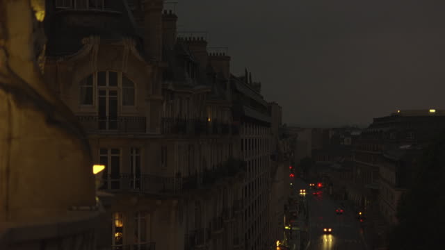 wide angle of paris apartment buildings or hotels. car traffic on boulevards or city streets. 19th century architecture dormer windows. - 1998 stock videos and b-roll footage