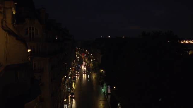 high angle down of paris city street. 19th century boulevards and architecture. dormer windows. - limousine stock videos & royalty-free footage