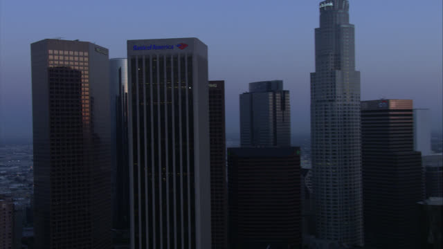 aerial of downtown los angeles skyline. camera zooms in on wells fargo building, gas company tower, paul hastings building, citinational bank, aon, citi, kpmg tower, deloitte and touche, and pacific telephone microwave tower. high rises, skyscrapers, and - microwave tower stock videos and b-roll footage