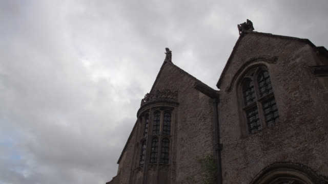 """up angle of medieval castle or church. could be estate. time lapse. cloudy, overcast sky. upper class.<p><a href=""""https://www.sonypicturesstockfootage.com/footage?kid=4338"""">for day-night matching shots, click here.</a><p> - https stock videos & royalty-free footage"""