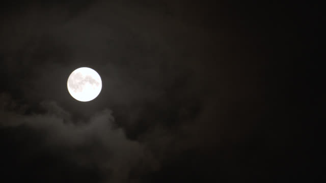 """up angle of clouds moving past full moon in night sky.<p><a href=""""https://www.sonypicturesstockfootage.com/footage?kid=4338"""">for day-night matching shots, click here.</a><p> - www stock videos & royalty-free footage"""