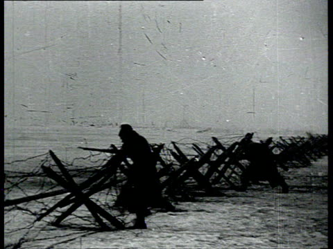 stockvideo's en b-roll-footage met 1mar1921 b/w montage suppression of kronstadt uprising dybenko in occupied kronstadt civil war winter fights barbed wire red army troops moving horse... - 1921