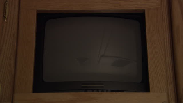 medium angle of television or computer screen, monitor, or display. screen is completely green or covered in green screen. see black desktop monitor, digital display, or lcd with wooden frame. - black entertainment television stock videos & royalty-free footage