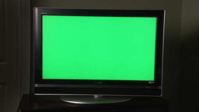medium angle of sony television or computer monitor. screen, monitor, digital display, or lcd has completely green screen. - chroma key stock videos & royalty-free footage