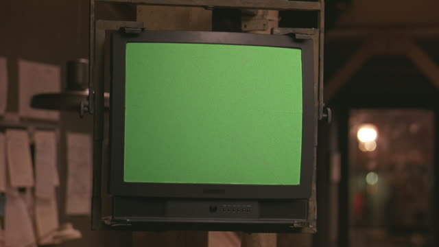 medium angle of television with green screen. - television chroma key stock videos & royalty-free footage