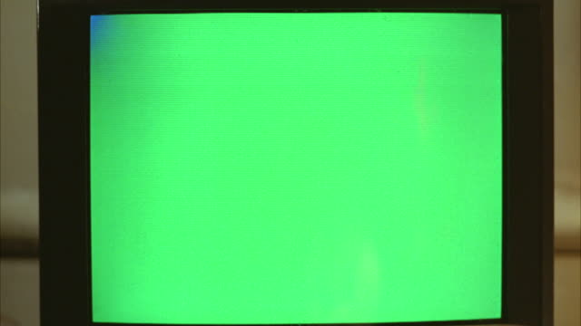 close angle of a green screen. could be television or computer monitor. could be in living room, den, or family room. could be used for playback. - television chroma key stock videos & royalty-free footage