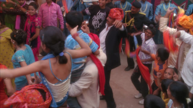 high angle down of crowd of people dancing at party, celebration, festival or wedding. - asia pac stock videos and b-roll footage