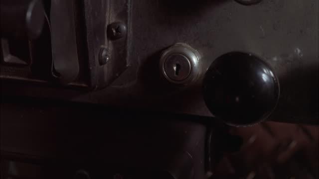 vídeos de stock, filmes e b-roll de close angle of hand turning key in ignition or starter of truck. series. - ignição