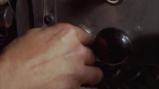 close angle of hand turning key in ignition or starter of truck. series. - ignition stock videos & royalty-free footage