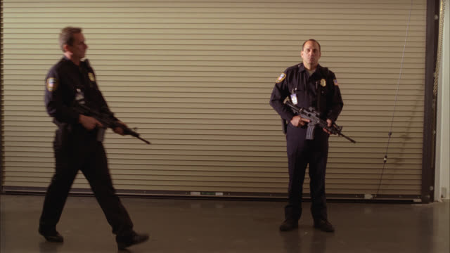 wide angle of armed security guard. guns. - guarding stock videos & royalty-free footage