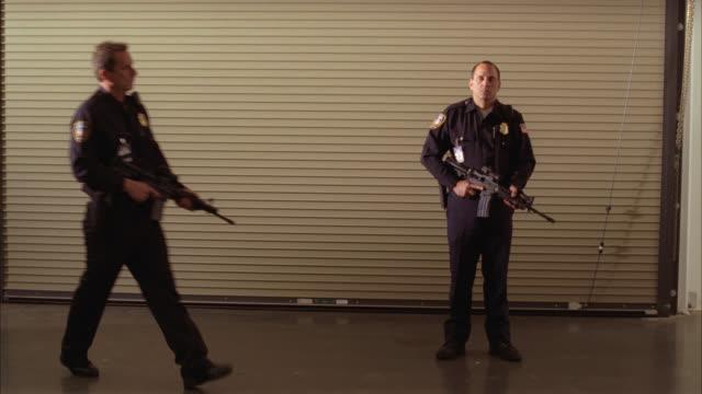 wide angle of armed security guard. guns. - fare la guardia video stock e b–roll
