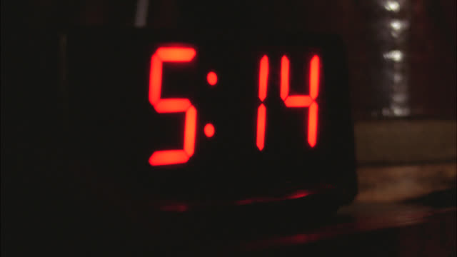 close angle of digital display on alarm clock. clock reads 5:14 and changes to 5:15. - clock stock videos & royalty-free footage