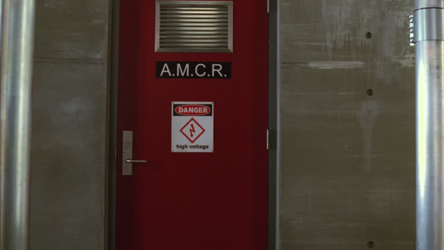 medium angle of door with high voltage sign. danger. - high voltage stock videos & royalty-free footage