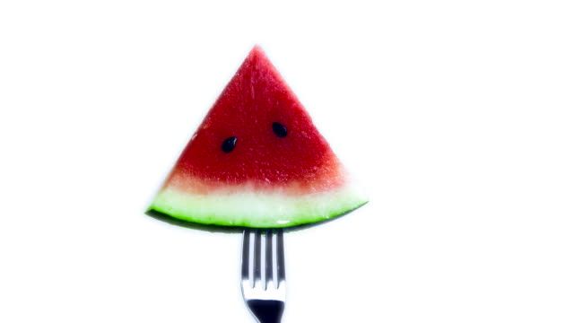 watermelon rotating on fork-looped-1080hd - slice stock videos and b-roll footage