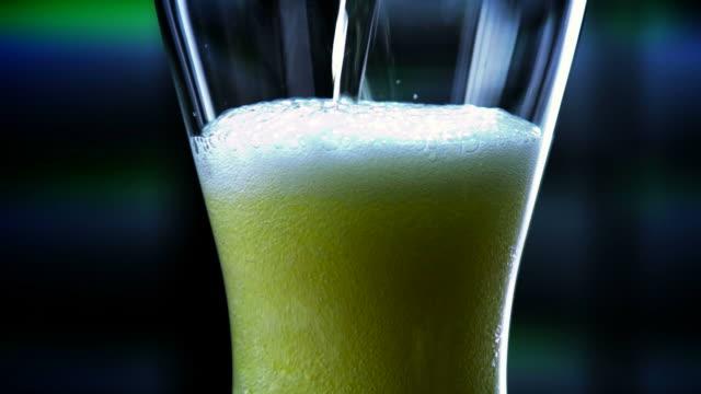 pilsner glass of beer filled-1080hd - pilsner stock videos & royalty-free footage