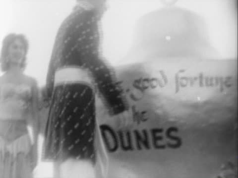 young showgirls dressed in revealing ancient arabian costumes posing for camera at opening ceremony of the dunes hotel casino / white male newsreel... - 1955 stock videos & royalty-free footage