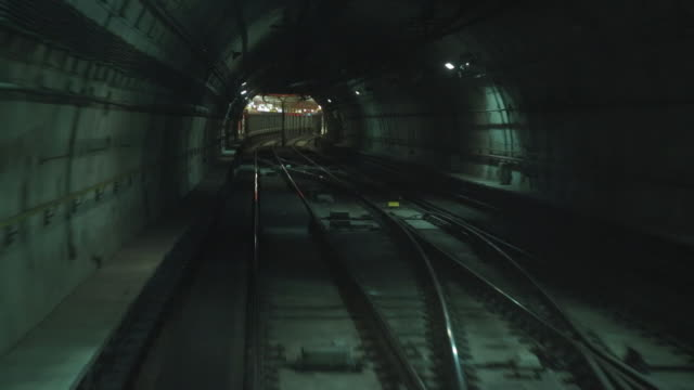 subway train entering tunnel - railway track stock videos & royalty-free footage