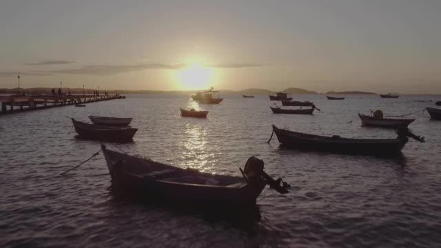 SEA AND BOATS AT SUNSET