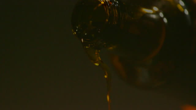 slo mo olive oil - olive oil stock videos & royalty-free footage